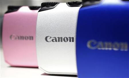 Canon digital cameras are displayed at the company's showroom in Tokyo