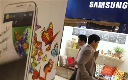 People walk at a Samsung Electronics store in Seoul