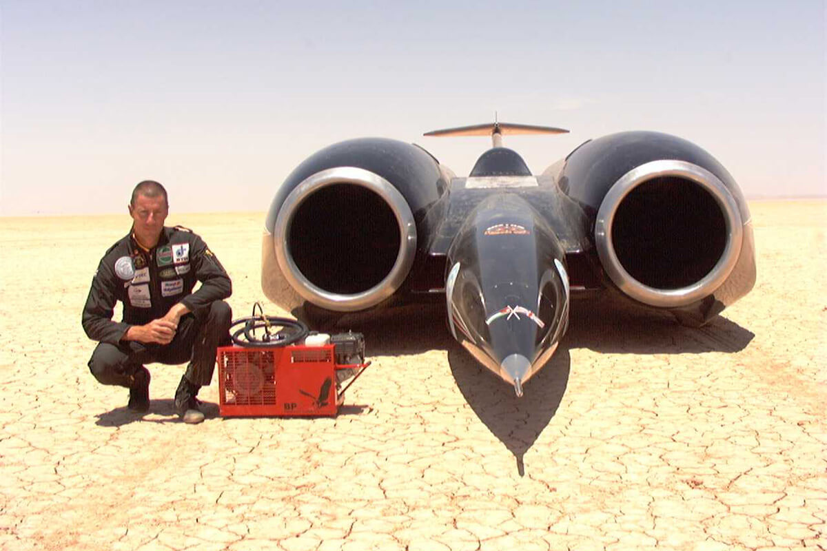 Andy Green Poses With Thrust SSC And The Compressor
