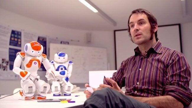 Обучающий письму робот