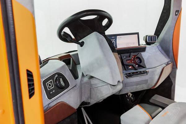 Два в одном. Бывший главный дизайнер BMW представил REDS: электрокар и передвижной офис